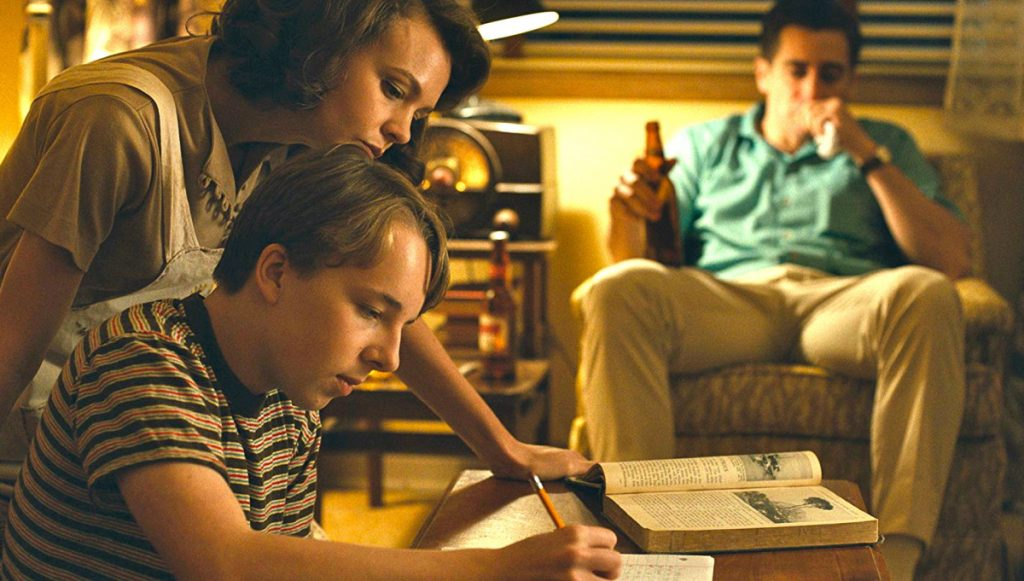 "Carey Mulligan, Ed Oxenbould and Jake Gyllenhaal in ""Wildlife."""