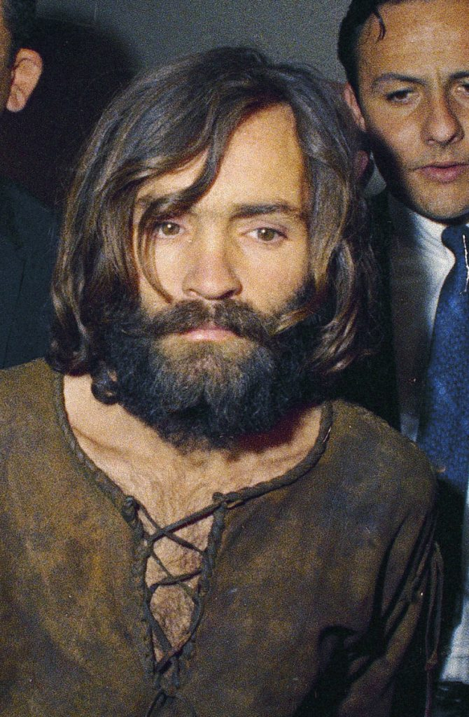 Charles Manson is led to his  arraignment in 1969.