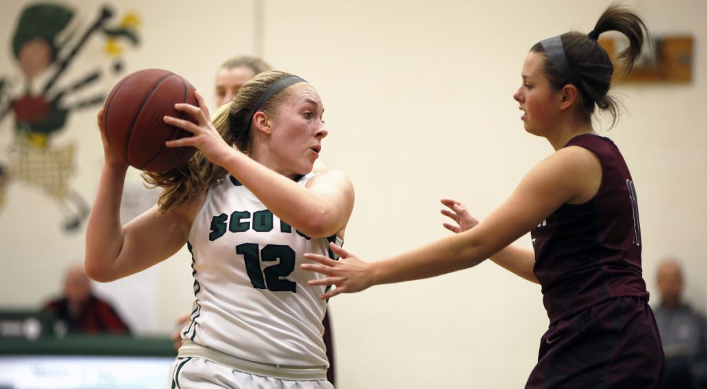 Deirdre Sanborn of Bonny Eagle keeps the ball away from Gorham's Brittany Desjardin during their Class AA South basketball game Friday night in Standish. Sanborn scored 12 points, including six in the fourth quarter, to lead the Scots to a 43-32 win.