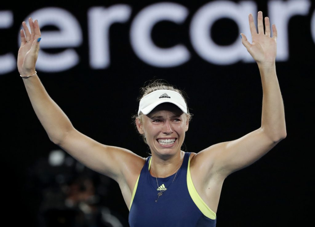 Caroline Wozniacki celebrates after defeating Simona Halep during the women's singles final at the Australian Open in Melbourne on Saturday.