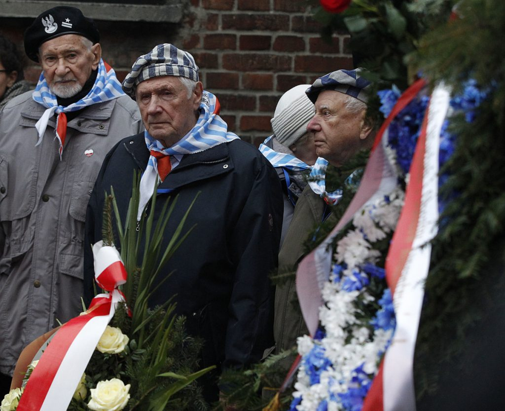 Auschwitz survivors remember those killed by Nazi Germany at the execution wall at the former Auschwitz death camp on International Holocaust Remembrance Day in Oswiecim, Poland, on Saturday.