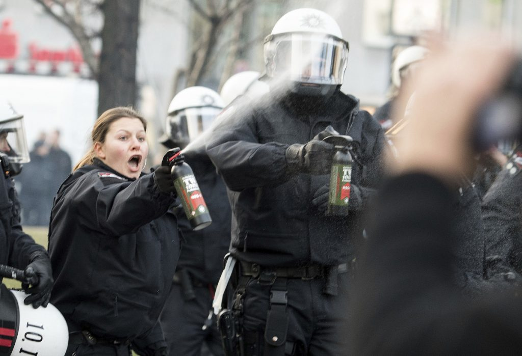 Police use tear gas as they clash with Kurdish demonstrators in Cologne, Germany, on Saturday.