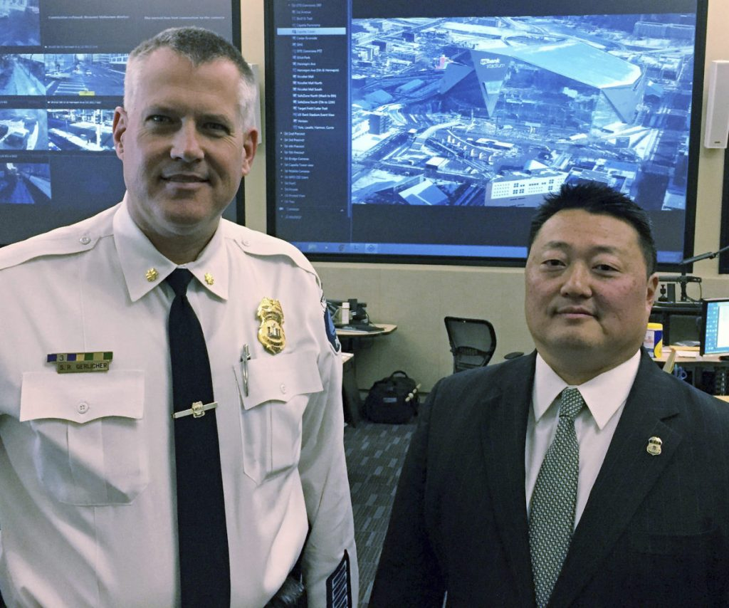 Minneapolis police Cmdr. Scott Gerlicher, left, and Homeland Security Investigations Special Agent in Charge Alex Khu meet in Fridley, Minn.