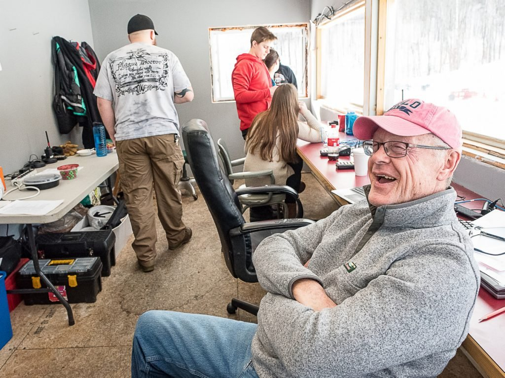Charlie Lever relaxes in the timing shack between the women's and men's races Saturday afternoon at Black Mountain.