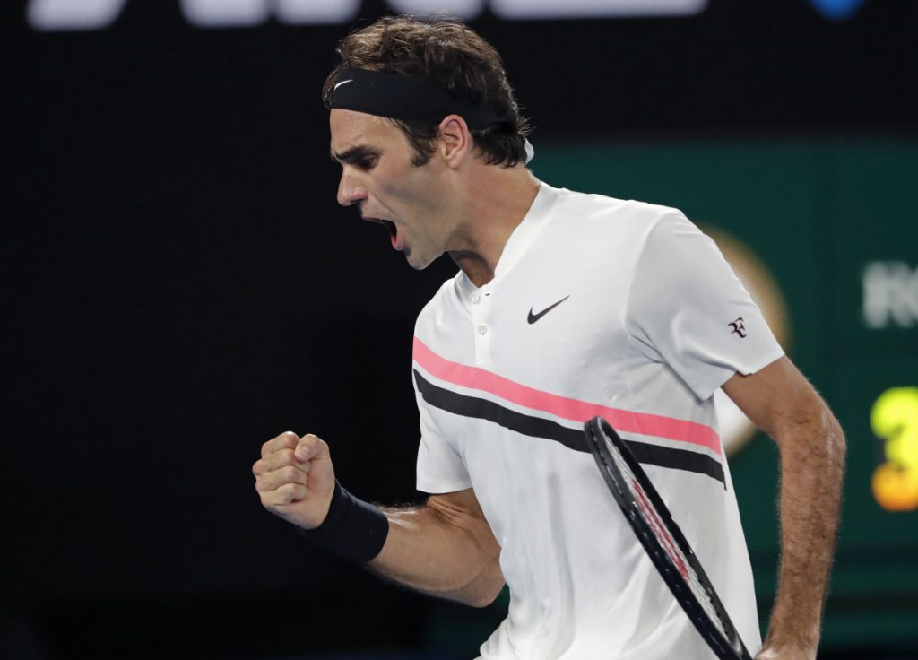 Roger Federer celebrates after winning a point against Croatia's Marin Cilic during the men's singles final at the Australian Open in Melbourne on Sunday.