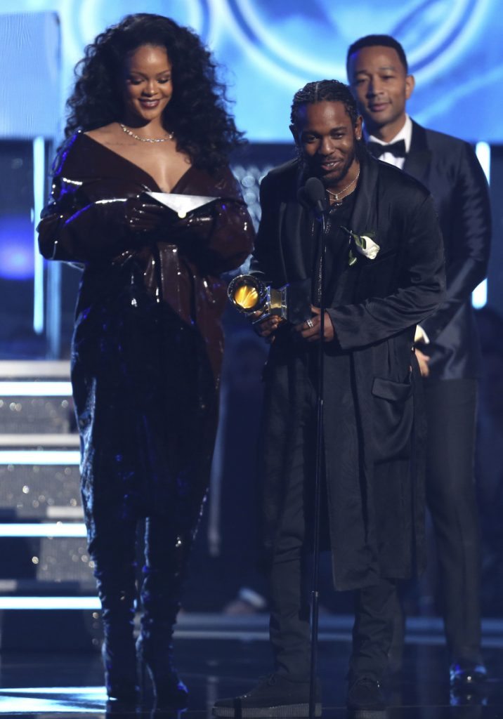 "Rihanna, left, and Kendrick Lamar accept the award for best rap/sung performance for ""Loyalty,"" from John Legend at the 60th annual Grammy Awards at Madison Square Garden on Sunday in New York."