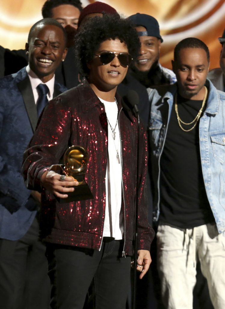 "Bruno Mars accepts the award for album of the year for ""24K Magic"" at the 60th annual Grammy Awards at Madison Square Garden on Sunday in New York."