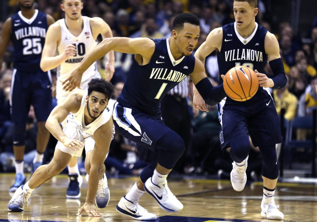 Jalen Brunson of Villanova heads down the court Sunday after stealing the ball from Markus Howard of Marquette during the second half of top-ranked Villanova's 85-82 victory at Milwaukee.