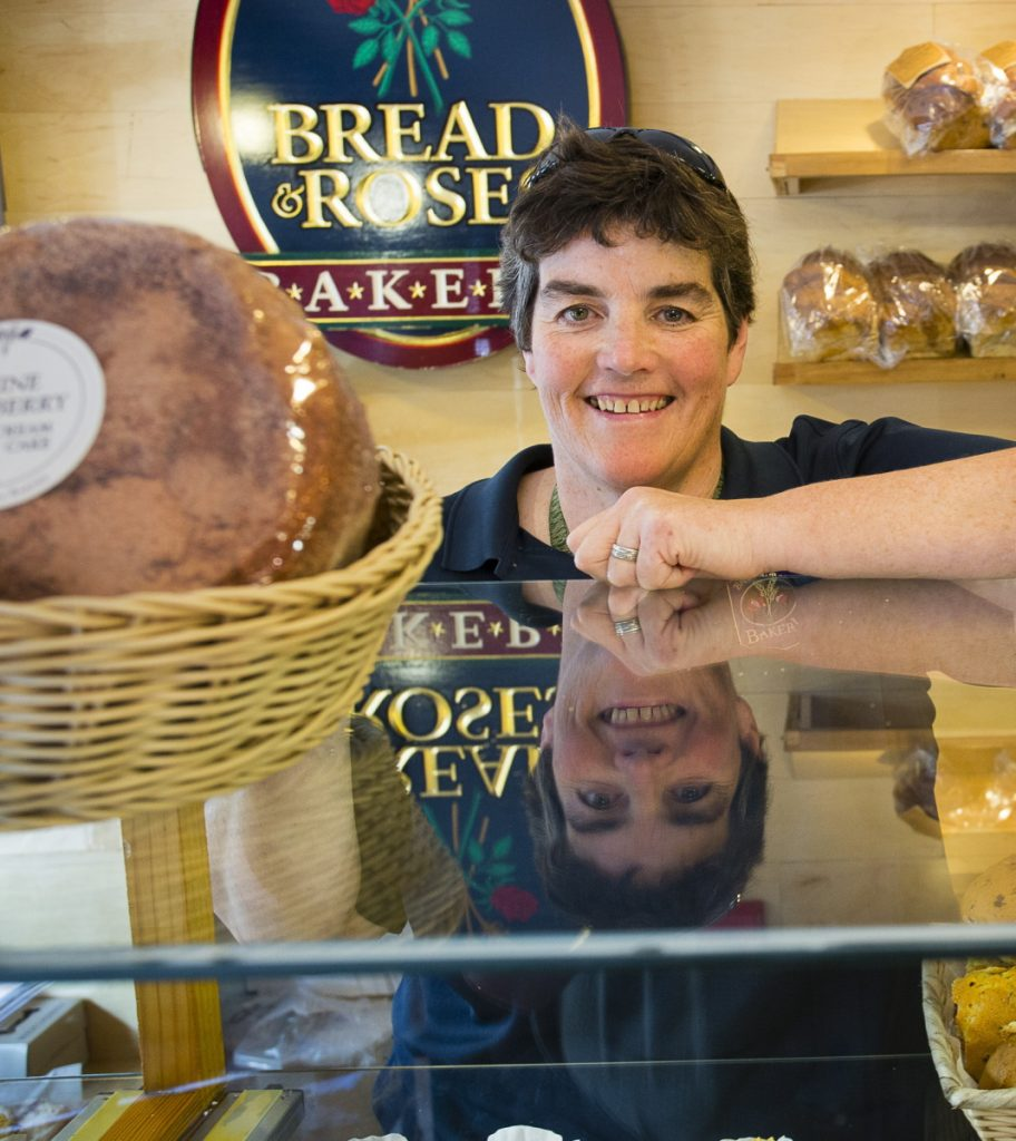 Bread and Roses Bakery owner Mary Breen smiles from over the counter in her Ogunquit shop in 2015.