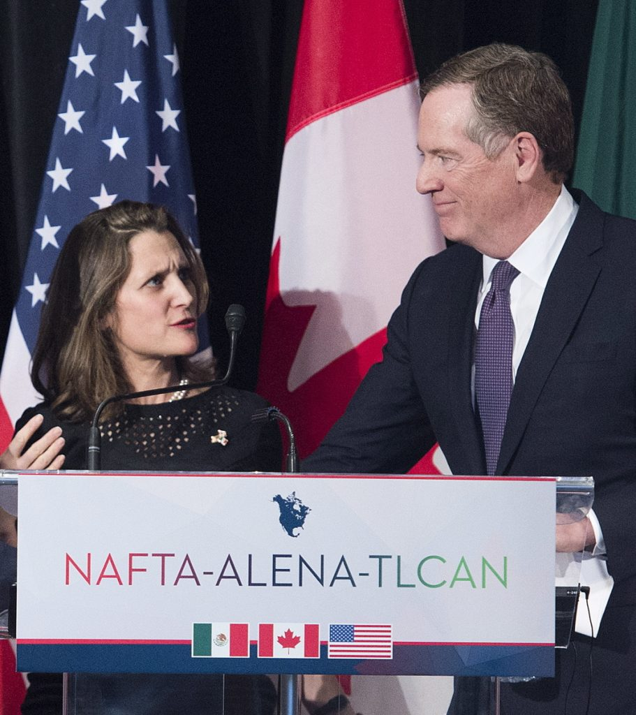 Canadian Foreign Minister Chrystia Freeland talks with U.S. Trade Representative Robert Lighthizer in Montreal on Monday.