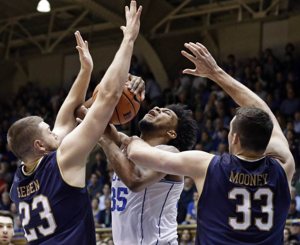 Duke's Marvin Bagley III takes a shot while being defended by Notre Dame's Martinas Geben, left, and John Mooney during the Blue Devils' 88-66 win Monday in Durham, N.C.