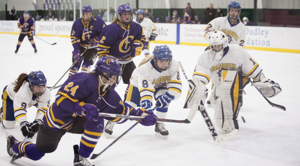 Abby Lamontagne of Cheverus slips past the defense Monday night to score during a 6-3 victory against Falmouth at the Family Ice Center. Lamontagne finished with two goals and four assists for the Stags, who are the top-ranked team in the South.