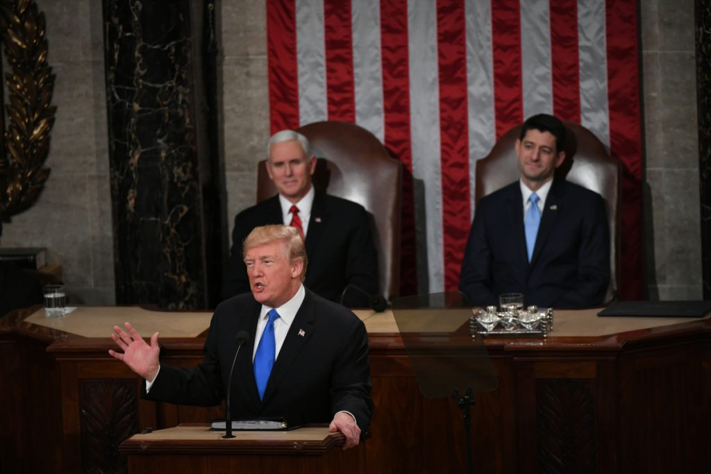 President Donald Trump delivers his first State of the Union address as Vice President Mike Pence and House Speaker Paul Ryan, R-Wis., listen on January 30, 2018.