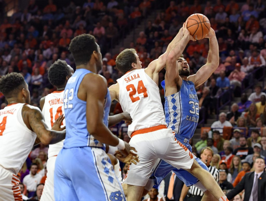 North Carolina's Luke Maye is pressured by Clemson's David Skara in the first half of Tuesday night's game in Clemson, S.C. Clemson, ranked 20th, ended a 10-game losing streak to the 19th-ranked Tar Heels, 82-78.