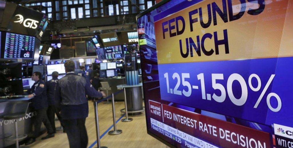A New York Stock Exchange television screen posts the decision of the Federal Reserve to leave unchanged its key short-term rate.