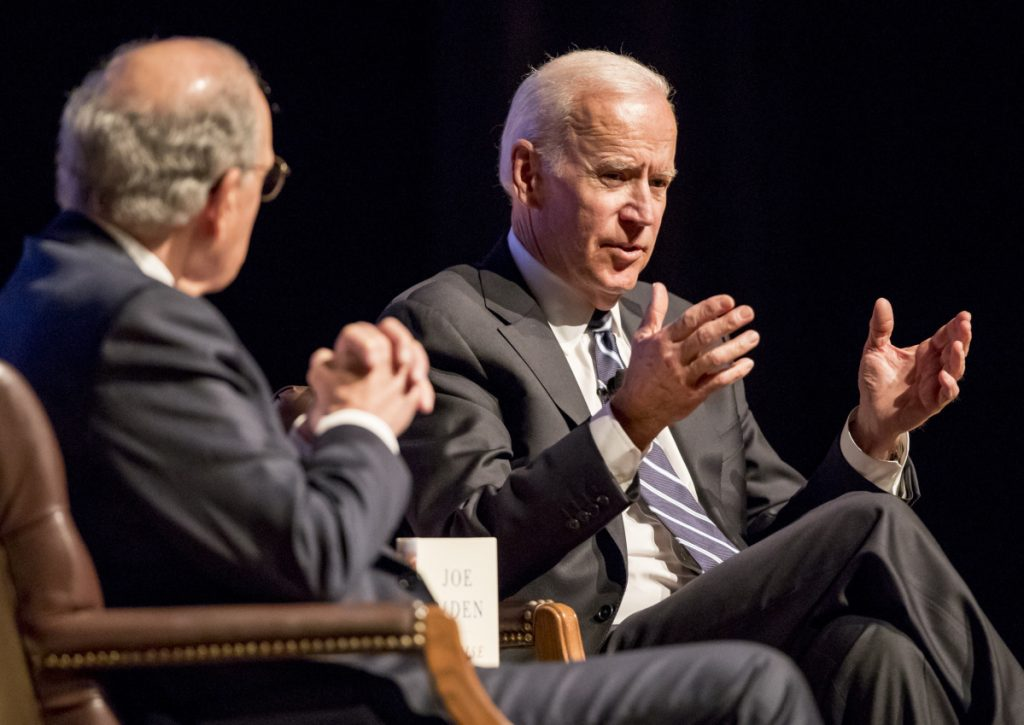 Former Sen. George Mitchell of Maine, left, chats with former Vice President Joe Biden Wednesday at Portland's Merrill Auditorium, where Biden talked about his new memoir.
