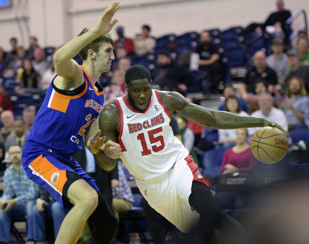 Anthony Bennett of the Maine Red Claws drives to the basket against Luke Kornet of the Westchester Knicks.