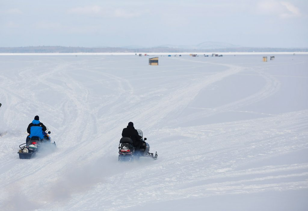 Ice fisherman haul their gear with snowmobiles Friday at Lower Bay on Sebago Lake. A Maine Warden Service spokesman said snowmobilers should avoid lakes and ponds unless they are certain of the ice conditions.