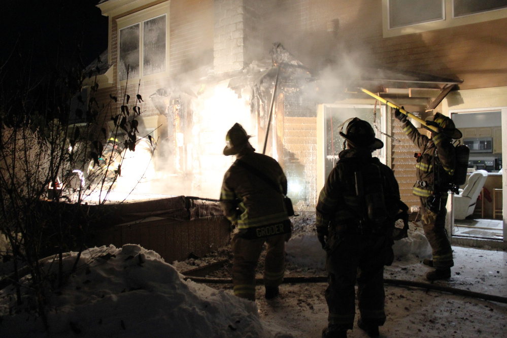 Firefighters from several departments fight a house fire on Waterville's Trafton Road early Wednesday morning.