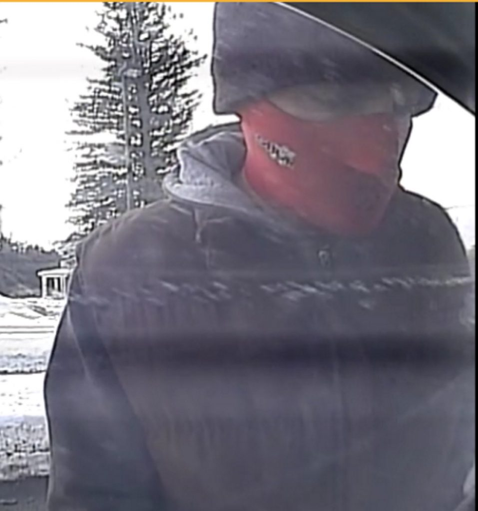 The robber appears on camera Tuesday at the Skowhegan Savings Bank branch in Norridgewock.