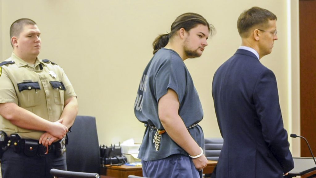 Andrew Balcer, center, stands with his attorney Walter McKeee during his arraignment Friday on two murder chargers and one of animal cruelty in the Capital Judicial Center in Augusta.
