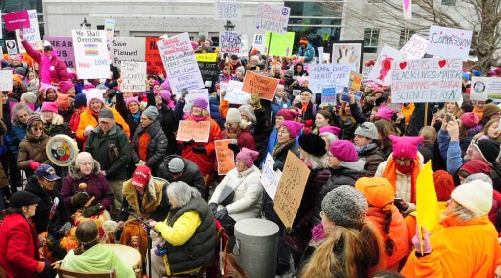 The Women of the Earth Drummers play the Red Hawk Medicine Drum to warm up the crowd on Jan. 21, 2017, before start of the Women's March on Maine at the Maine State House in Augusta. Another rally is planned for Saturday, one year after the original protest gathering.