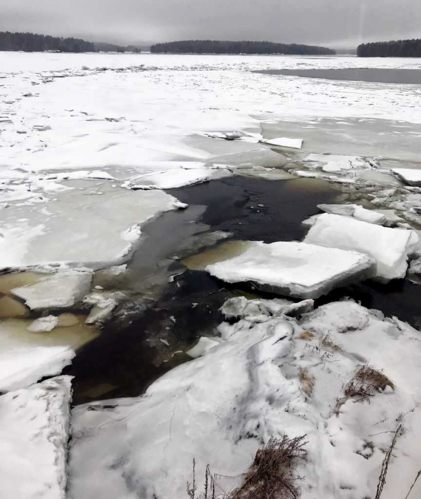 Ice chunks cling to the Kennebec River shore on Tuesday at Chop Point School in Woolwich, where U.S. Coast Guard vessels are scheduled to arrive Wednesday as part of an early ice-breaking operation to ward off flooding near Augusta.