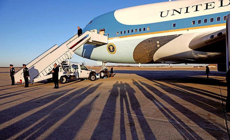 President  Trump descends the steps of Air Force One in late afternoon shadows upon his return to Joint Base Andrews in Maryland on  Jan. 18, 2018.