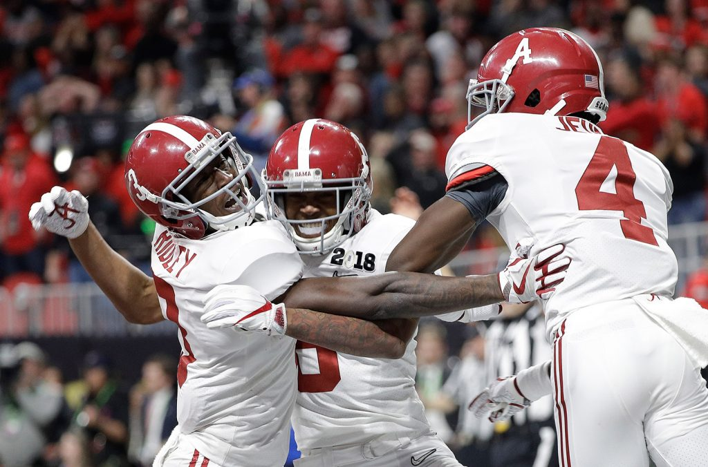 Alabama wide receiver DeVonta Smith (6) celebrates his touchdown during overtime of the NCAA college football playoff championship game against Georgia on Monday in Atlanta. Alabama won 26-23 in overtime.