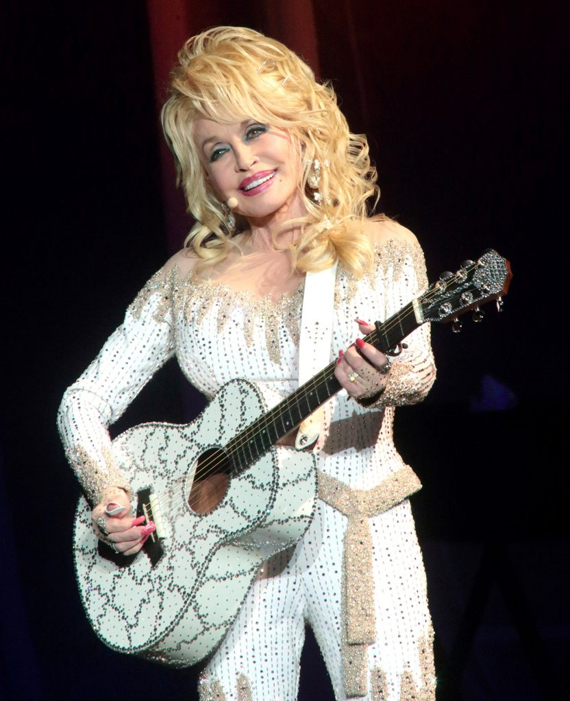 """Parton performs in concert during her Pure & Simple Tour in Philadelphia last year. Parton has discarded """"Dixie"""" from the name of a popular dinner show."""