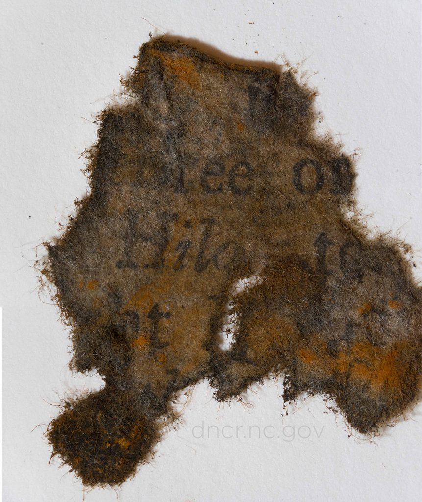 This piece of paper from a book was found on board Blackbeard's ship the Queen Anne's Revenge. To find paper in the 300-year-old shipwreck in warm waters is
