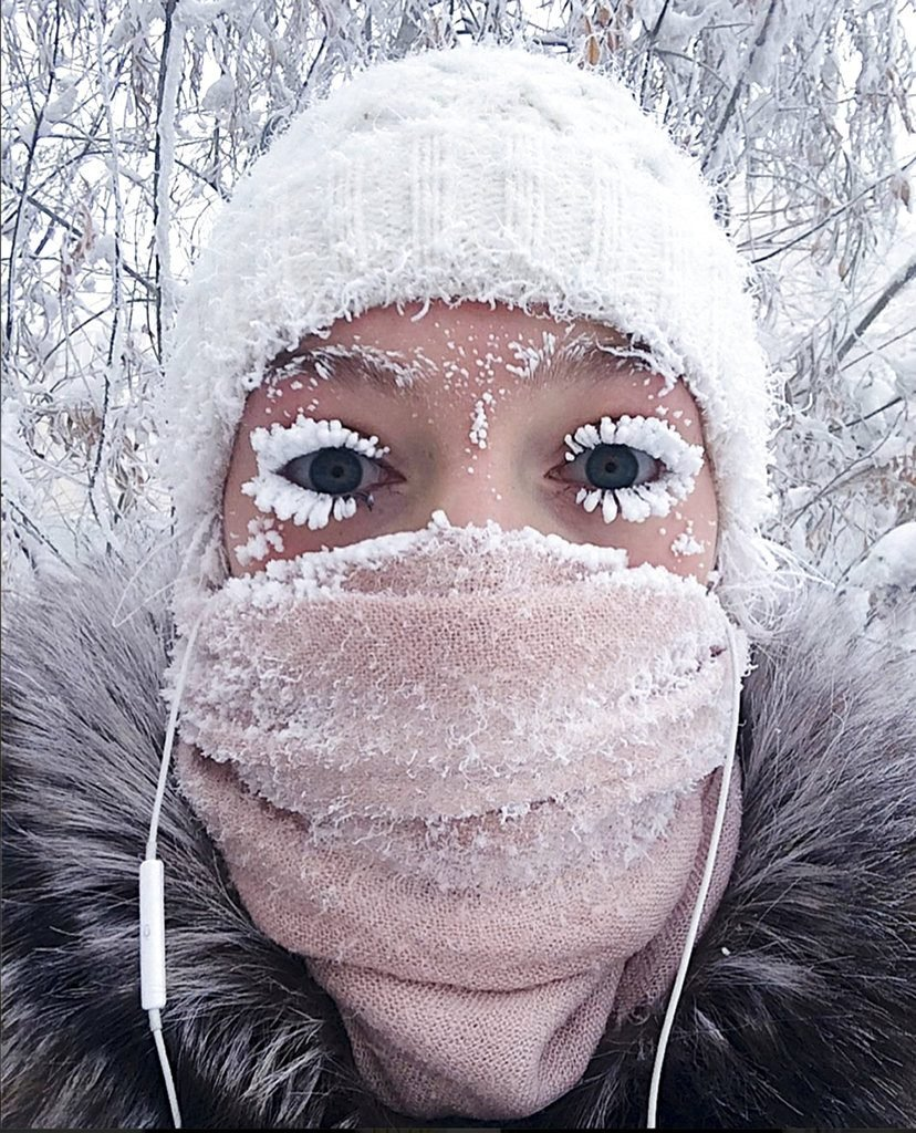 In this photo taken on Sunday, Anastasia Gruzdeva poses for selfie as the temperature dropped to about minus 58 degrees Fahrenheit in Yakutsk, Russia.    sakhalife.ru photo via AP