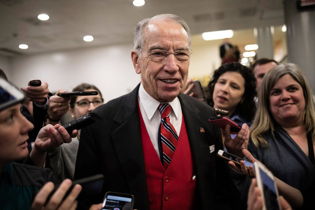 Senate Judiciary Committee Chairman Chuck Grassley, R-Iowa, speaks with reporters at the Capitol in Washington on Thursday. On Thursday, Grassley released some previously recovered texts from the FBI discussing the Clinton email probe that Republicans say call into question whether she had been treated too gently.