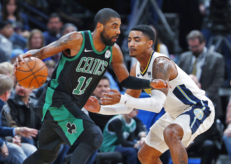 Celtics guard Kyrie Irving drives past Nuggets guard Gary Harris in the first half of Monday night's game in Denver. Irving finished 11 of 17 from the field to lead the Celtics in scoring.