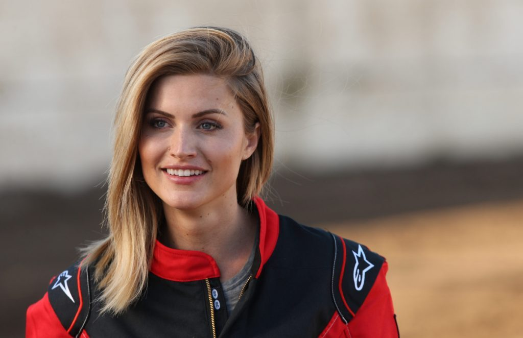 "Chelsea Roy competing in a demolition derby on an episode of ABC's ""The Bachelor."""