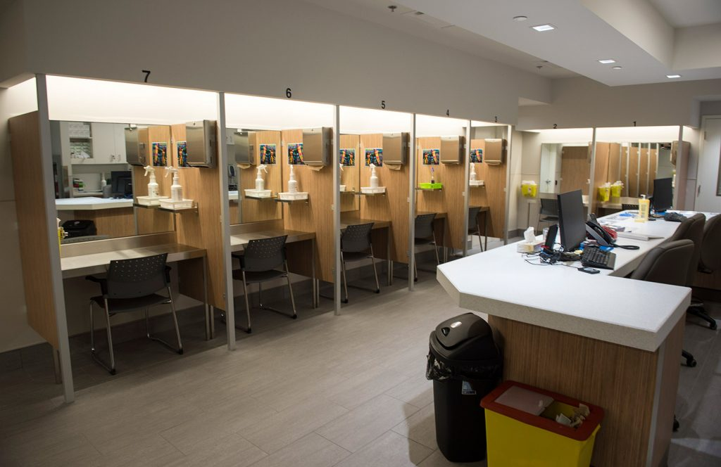 "Booths line the Cactus ""safe injection site,"" where drug addicts can shoot up using clean needles, get medical supervision and freedom from arrest, in July in Montreal. The sites are one strategy used in Canada as it tries to counter the high rate of overdose deaths."