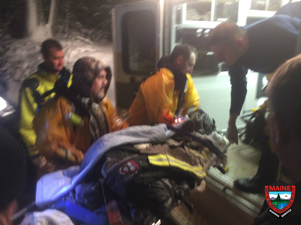 Eli Strauss is loaded into an ambulance Wednesday night after the rescue near Long Pond on Mount Desert Island.