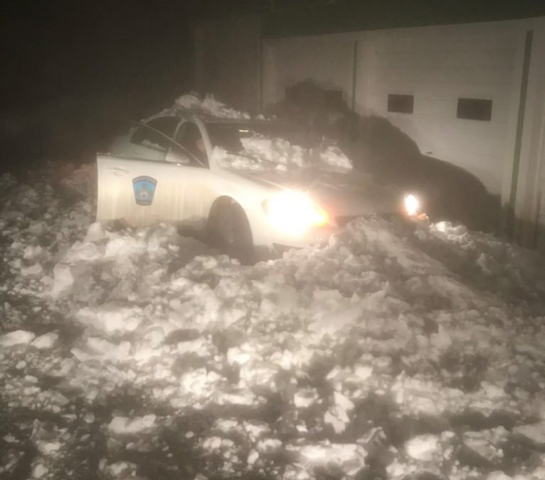 A Capitol Police cruiser is seen Thursday after snow and ice slid off the roof of a state-owned building and crushed the vehicle.