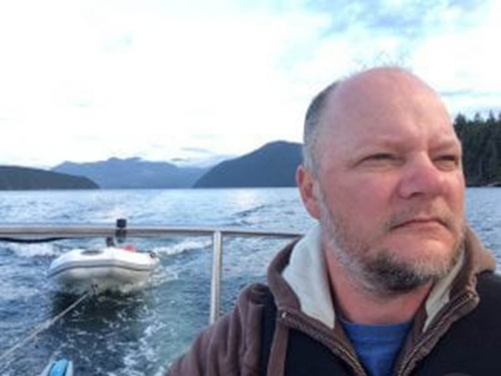 Scott Tilley, pictured near his home in Canada, found a NASA satellite, above, that had been lost for more than a decade.