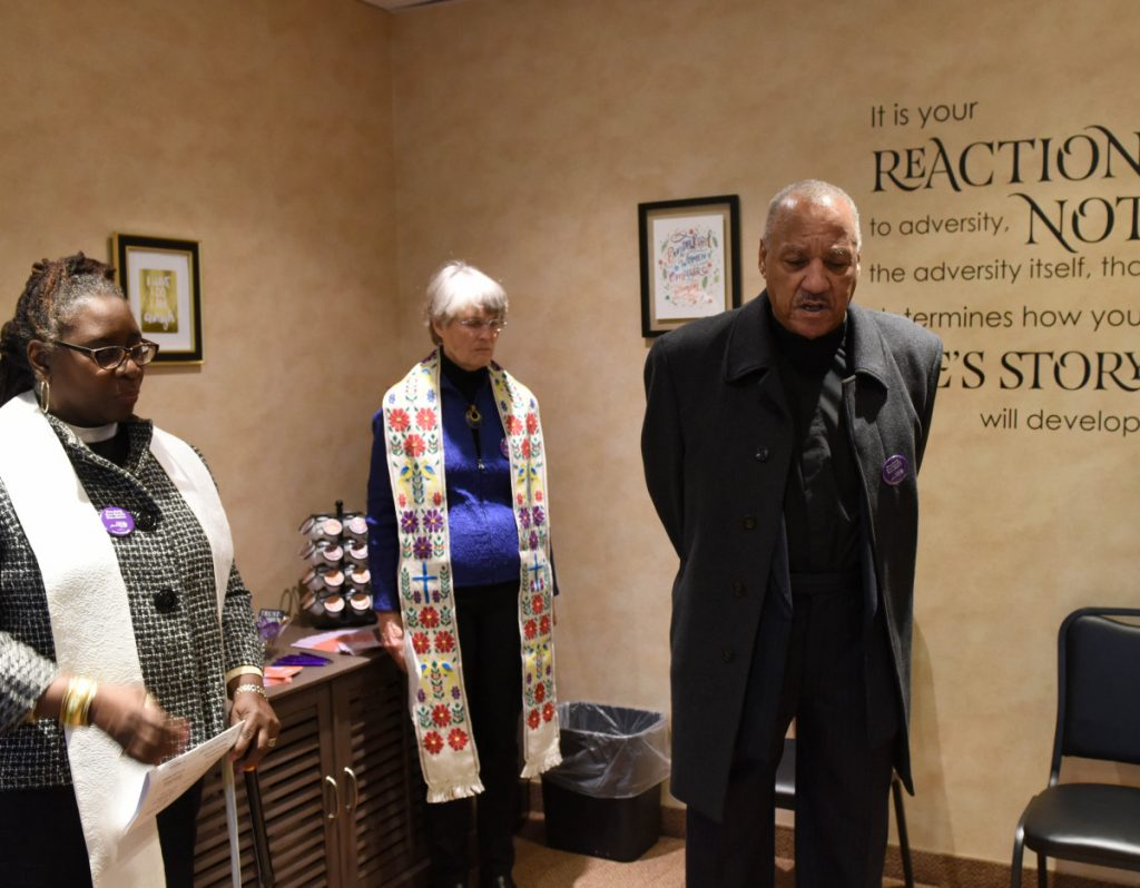 The Rev. Dr. Carl Jackson, center right, Rabbi Charles Feinberg, right, Rev. Dr. Cari Jackson, left, and Rev. Barbara Gerlach pray at an abortion clinic in Bethesda, Md., on Monday.