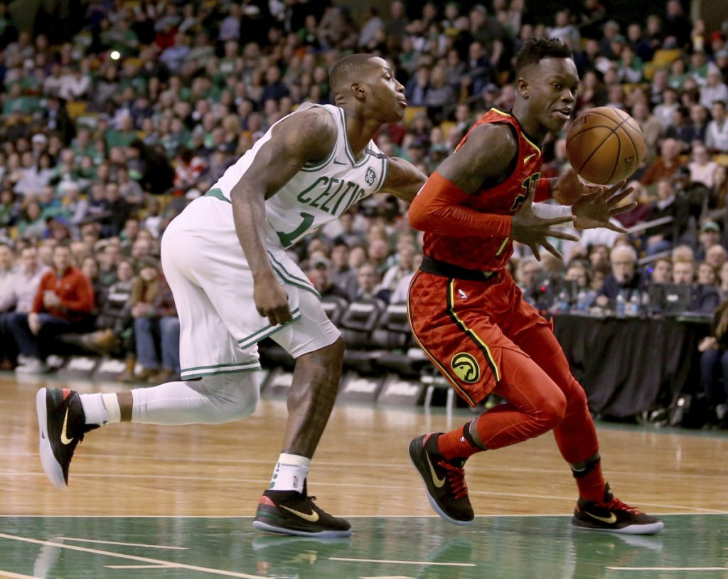 Boston's Terry Rozier knocks the ball loose from Atlanta's Dennis Schroeder in the first half Friday night in Boston.