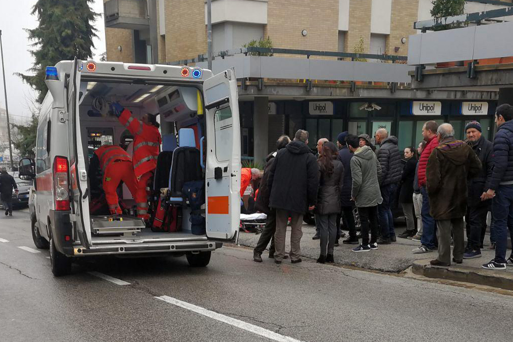 Paramedics attend a wounded man after a shooting broke out in Macerata, Italy on Saturday. Italian police arrested a lone gunman in a series of drive-by shootings targeting foreigners Saturday morning that paralyzed a small central Italian city still reeling from the gruesome murder of a young Italian woman allegedly at the hands of a Nigerian immigrant.