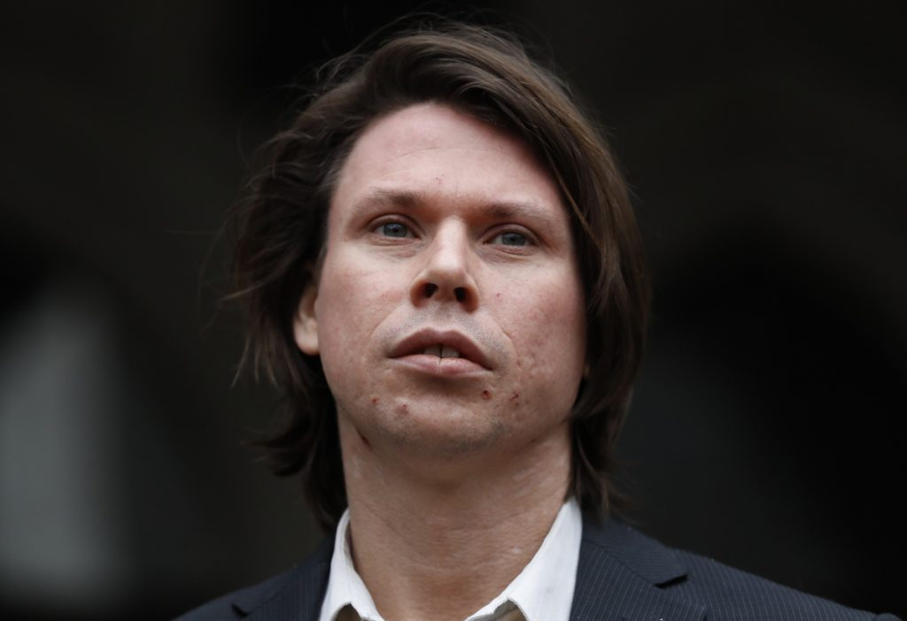 Lauri Love, who is accused of hacking into U.S. government computers, stands outside The Royal Courts of Justice in London on Monday. A British court ruled in Love' favor on his appeal against extradition to the United States, where he faces solitary confinement and a potential 99 year prison sentence.