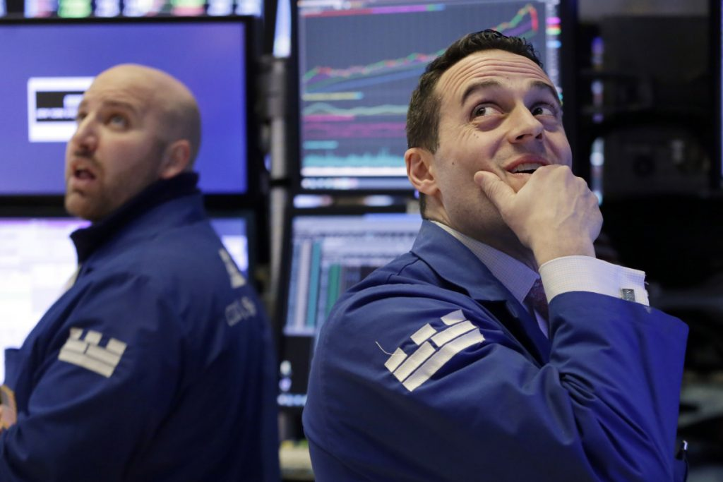 Specialists John Parisi, left, and Michael Gagliano work on the floor of the New York Stock Exchange on Monday. The Dow Jones industrial average plunged more than 1,100 points Monday as stocks took their worst loss in six and a half years.