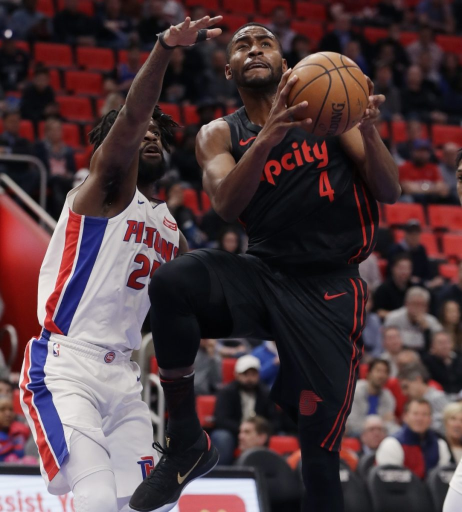 Portland's Maurice Harkless takes a shot while being defended by Detroit's Reggie Bullock during the Pistons' 111-91 win Monday in Detroit.