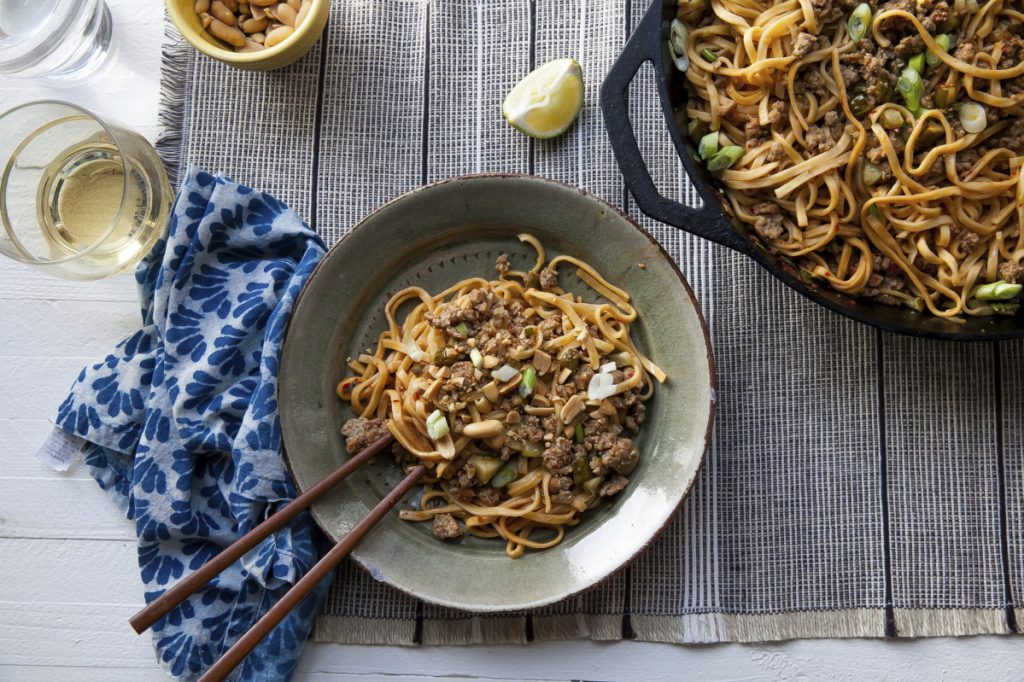 Dan Dan Noodles are basically long, skinny noodles topped with a flavorful sauce built on ground pork and seasoned with pickled vegetables.