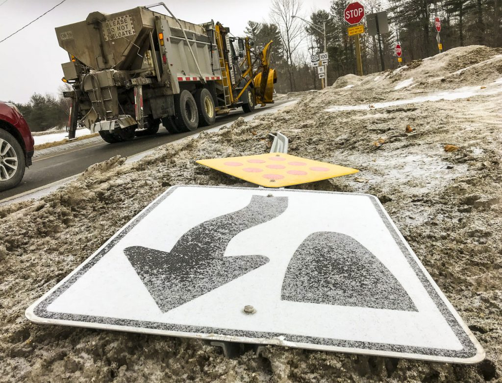 A toppled sign lies along the edge of Main Street on Tuesday in Winthrop. The sign is intended to direct drivers turning off U.S. 202 to stay to the right, but it was knocked over last week in a crash. Local police have notified the state Department of Transportation about the downed sign, while town officials are asking the department to review the area's new traffic pattern after a recent spike in crashes.