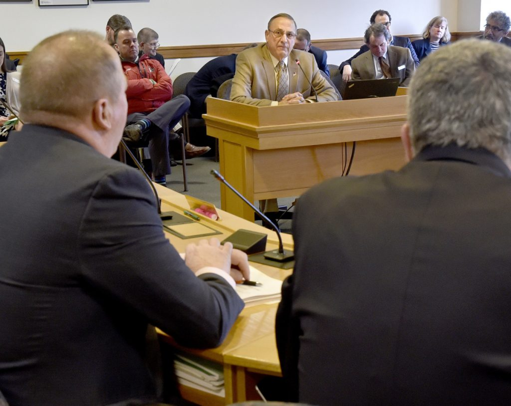 Gov. Paul LePage listens Tuesday during an appearance before the Joint Standing Committee on Taxation in support of L.D. 1629, a bill titled