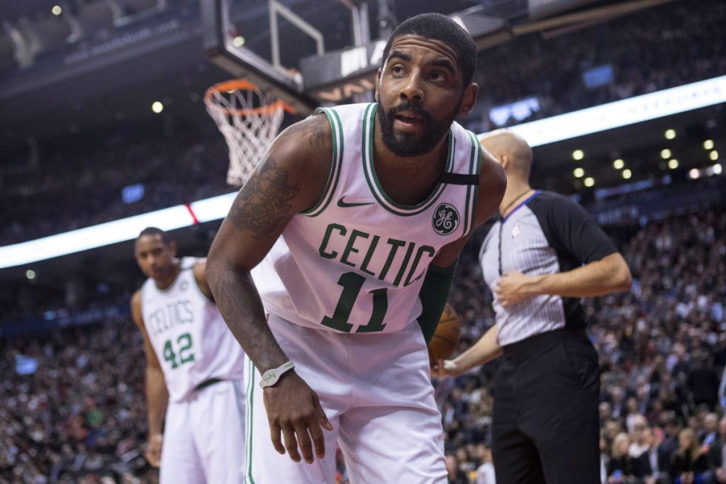 Boston Celtics guard Kyrie Irving gets up from the court during the second half of the team's the Celtics 111-91 loss to the Raptors in Toronto on Tuesday night.