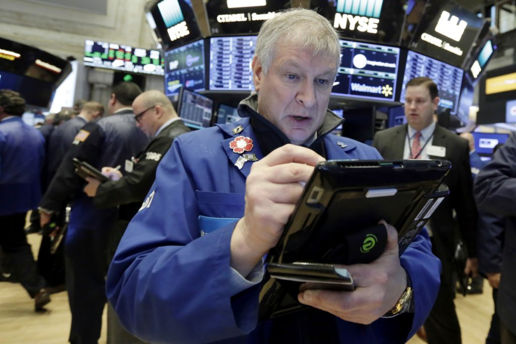 Trader Richard Newman works on the floor of the New York Stock Exchange on Wednesday. Associated Press/Richard Drew